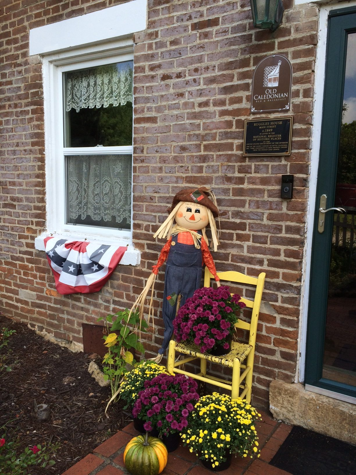 A cute scarecrow outside the entrance of the Old Caledonian