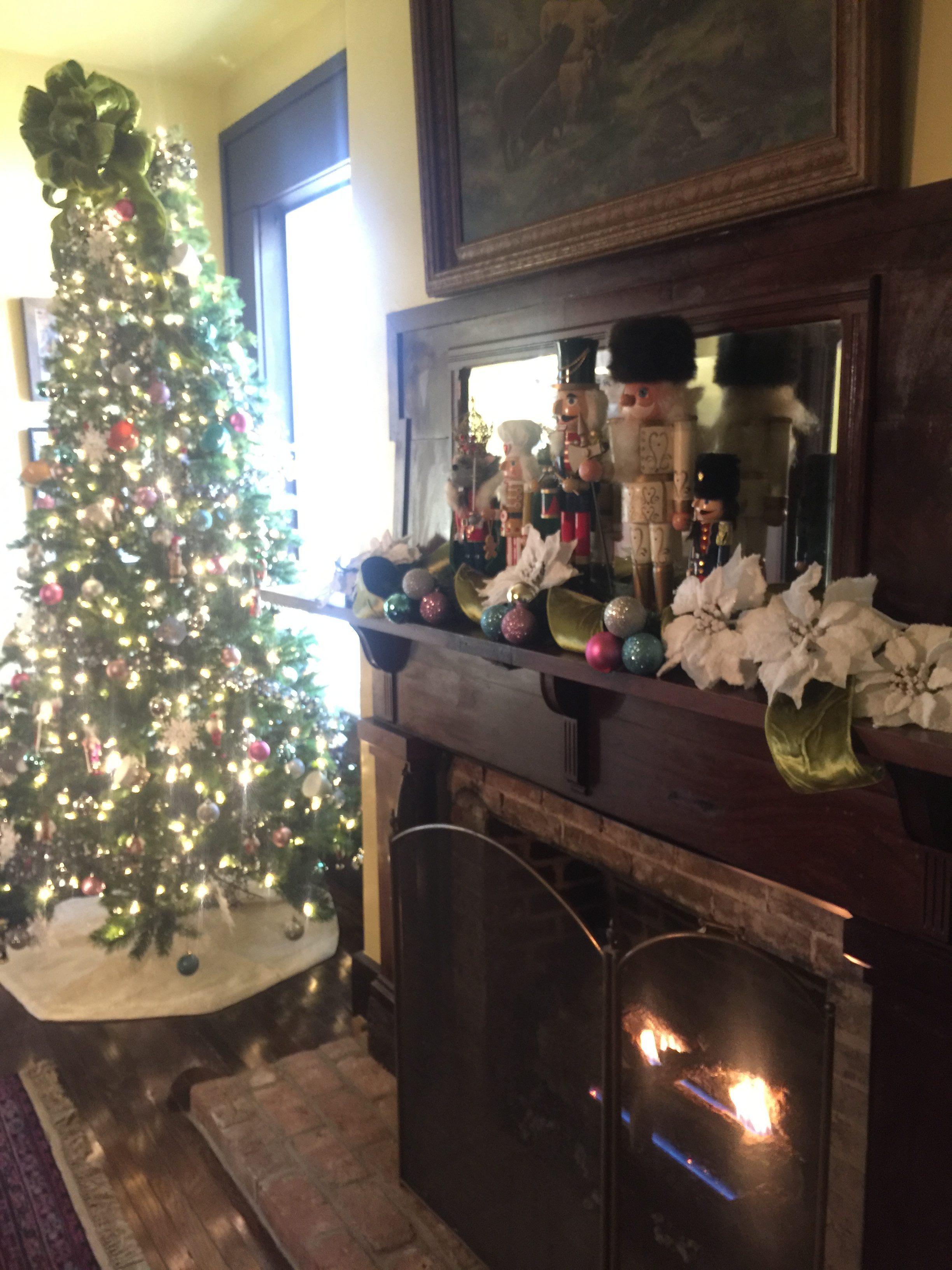 A christmas tree and decorated mantle at the OCBB