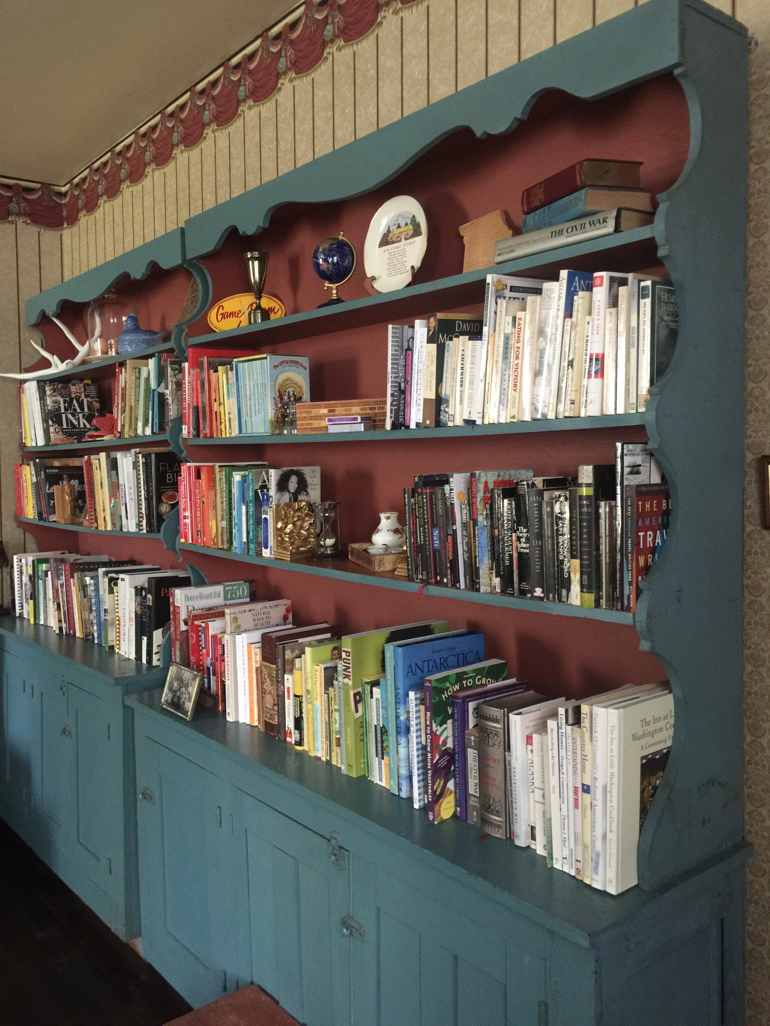 The former display cases from Chanticleer, now our Library's bookshelves.