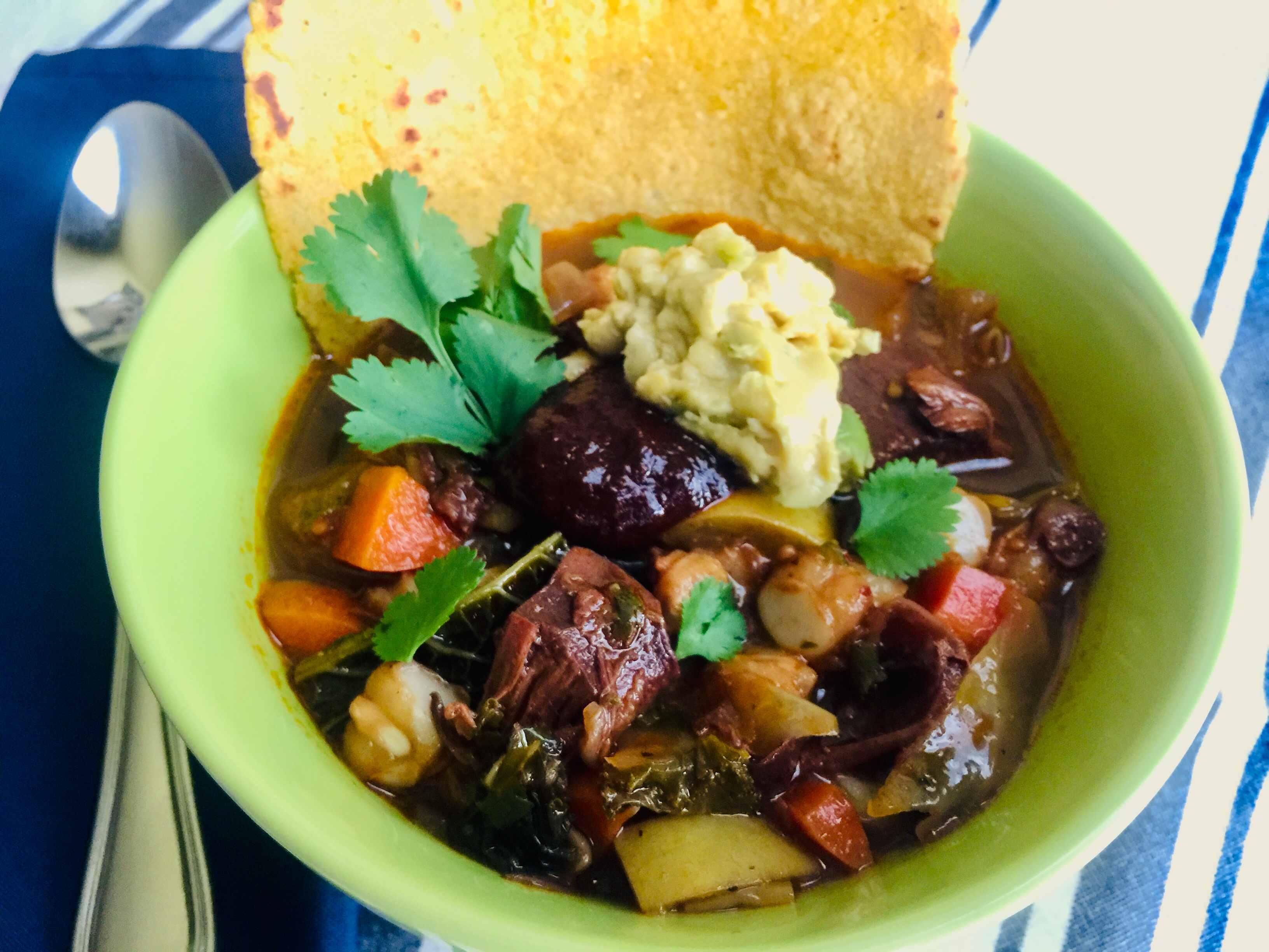 Scrumptious bowl of jackfruit posole with a homemade tortilla