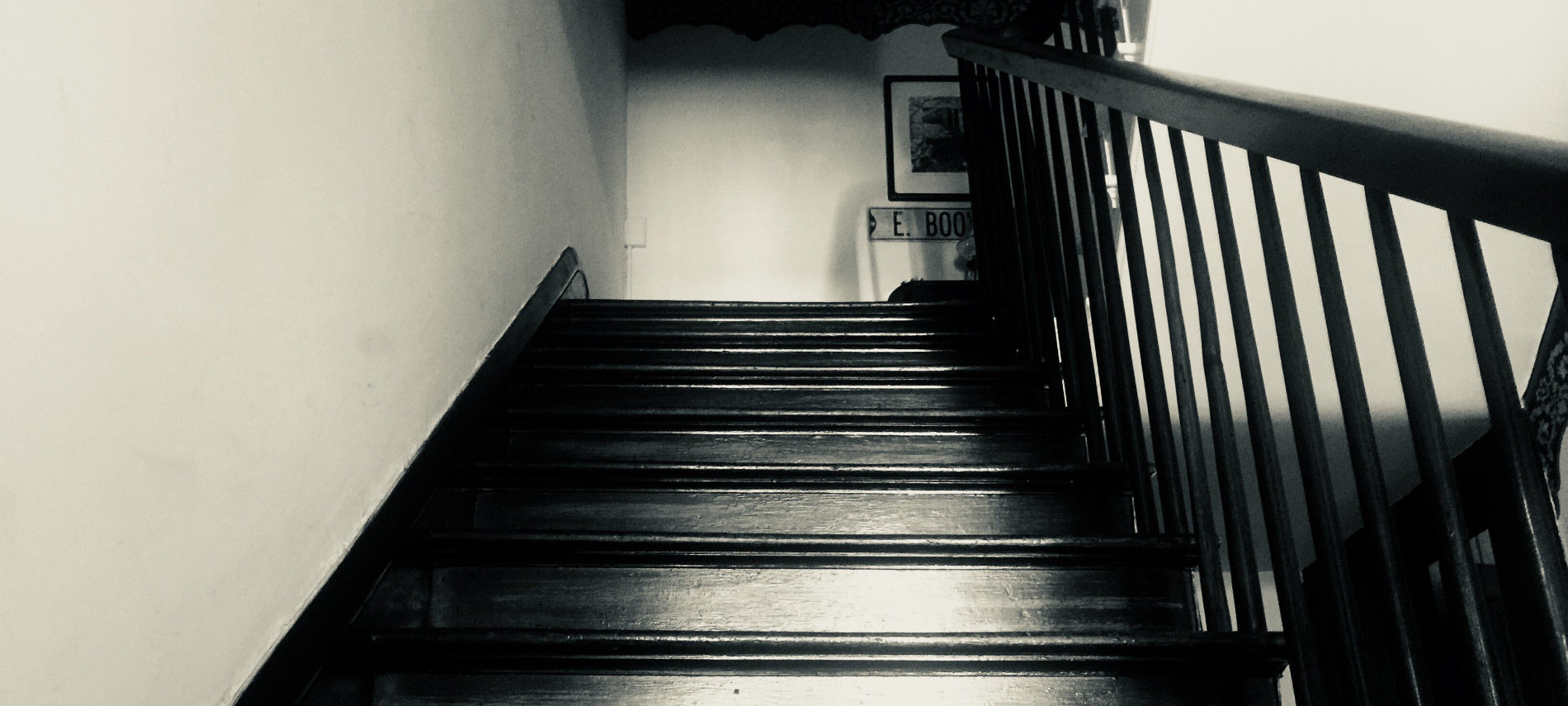 A spooky photo in black and white of the stairs at the OCBB