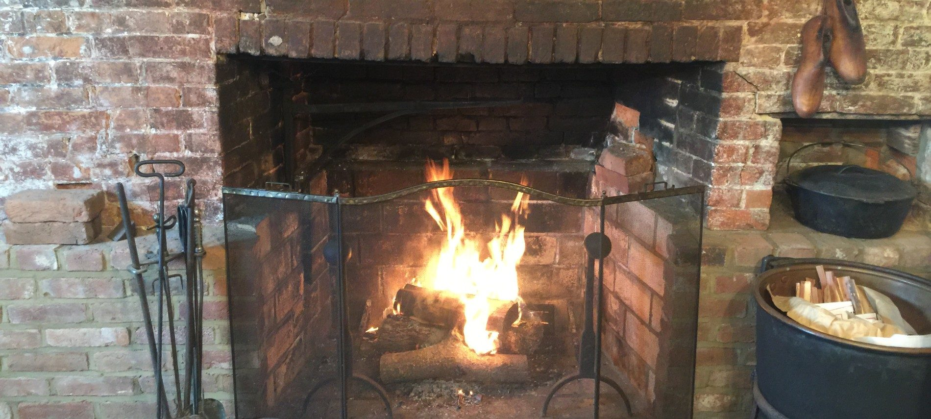 Featured image of the fireplace at the Old Caledonian